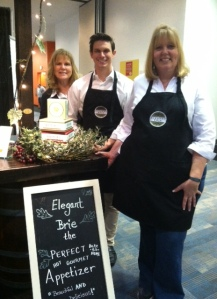 Elegant Brie booth at SF Fancy Food Show 2014. Crew includes of Leslie (The Big Cheese) and Linda (Chief Cheese Officer).